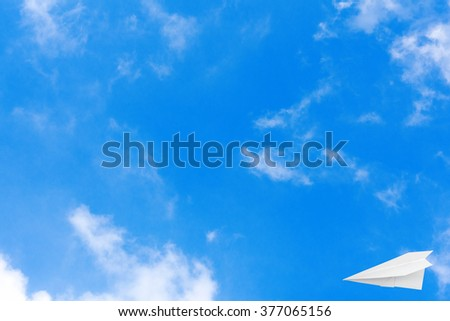 Plane paper on the blue sky with copy space, - stock photo