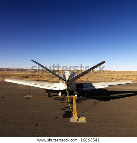 Plane parked on tarmac at Canyonlands Field Airport, Utah, United States.