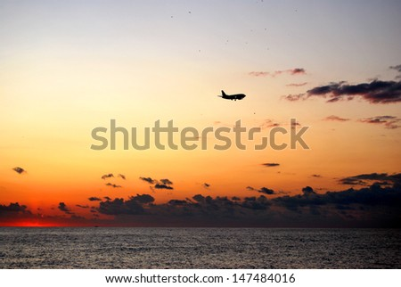 plane silhouette at sunset