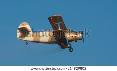 Plane spraying insecticide against mosquitoes invasion - stock photo