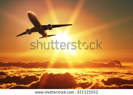 Plane takes off at sunrise  - stock photo