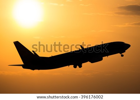 Plane taking off from the airport with sunset sky in the background. Boeing 737. Airplane flight. Travelling by plane. Travel.  - stock photo