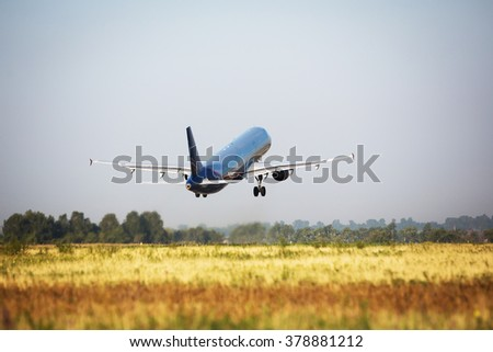 plane taking off in the airport - stock photo