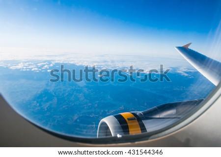 Plane window view - stock photo
