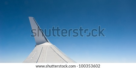 Plane wing with sky background with copy space.