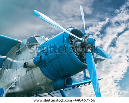 plane with propeller on beautiful bright sky background - stock photo