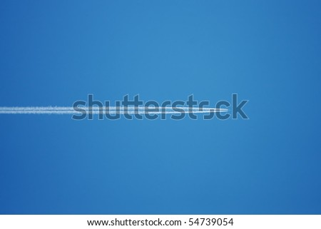 Plane with vapor stripes - stock photo