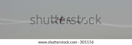 planes in airshow - stock photo