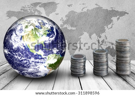 Planet and coins on wooden pavement, Elements of this image furnished by nasa. - stock photo