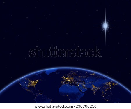 Planet earth and Christmas star in night sky. Elements of this image furnished by NASA. - stock photo