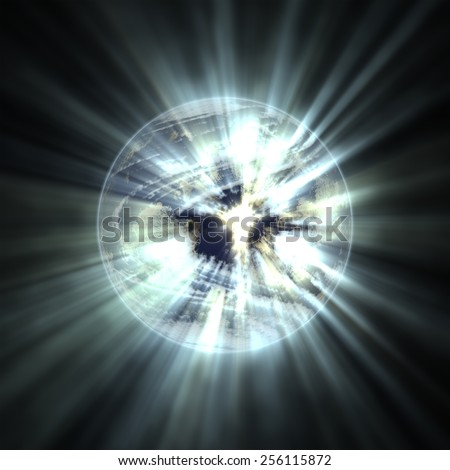 Planet earth emitting rays of light - stock photo