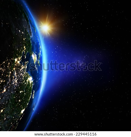 Planet Earth from space sunrise. Elements of this image furnished by NASA - stock photo
