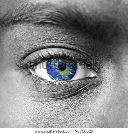 "Planet earth in blue human eye - ""Elements of this image furnished by NASA"" - stock photo"