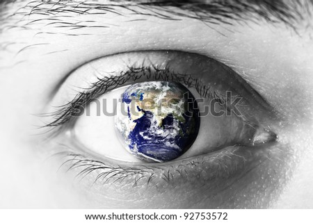 Planet earth  in eye - stock photo