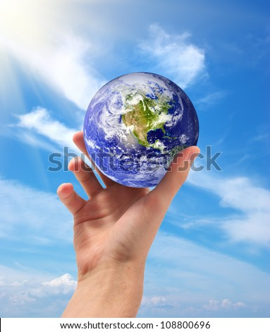 Planet Earth in hand. Conceptual design. Elements of this image furnished by NASA - stock photo