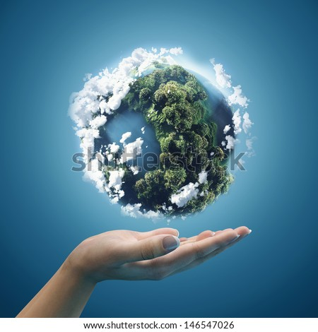 Planet earth in hands - stock photo