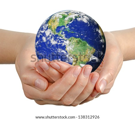 Planet earth in palm.Elements of this image furnished by NASA