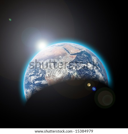 planet earth in space with sunrize - stock photo