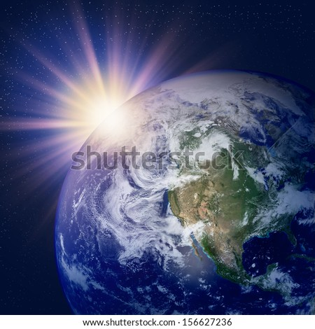 Planet earth with sunlight - stock photo
