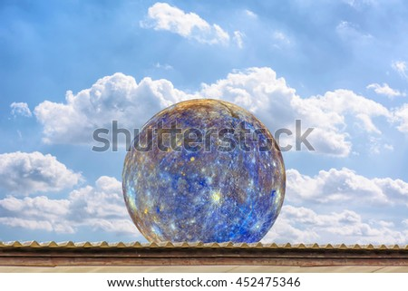 Planet Mercury on the roof, on the blue sky. Elements of the furnished by NASA.
