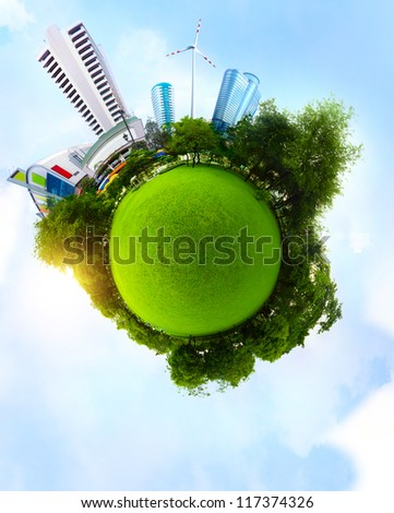 Planet with green meadow and trees and tall urban buildings with blue sky on the background - stock photo