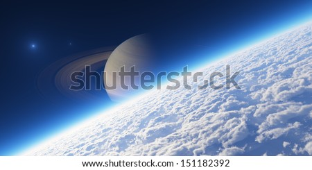 Planet with rings at sunrise. Elements of this image furnished by NASA. - stock photo