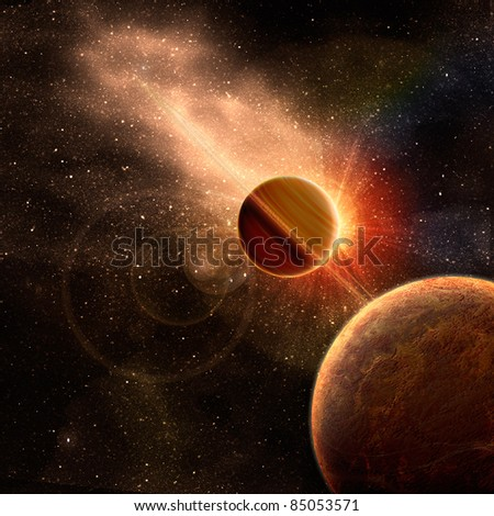 planet with rings at sunrise on the background of the cosmos - stock photo