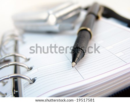 planner, cell phone and pen - stock photo