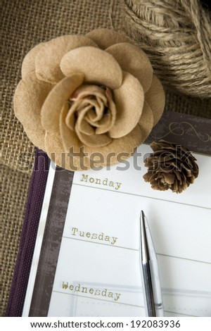 planner open on weekly page with flower decoration - stock photo