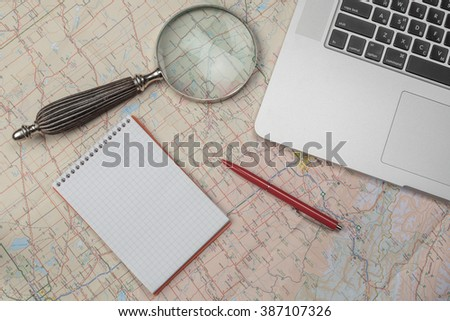Planning and preparation of travel with computer via internet - stock photo