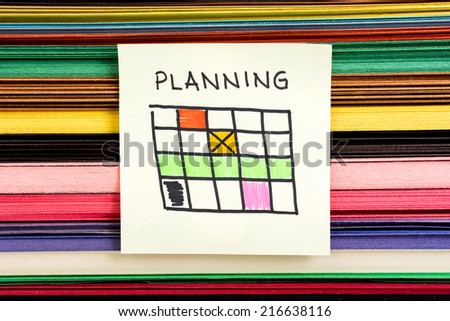 Planning calendar concept on multicolor background - stock photo