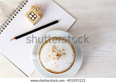 planning household tasks with a cup of coffee/business planning with an appetite