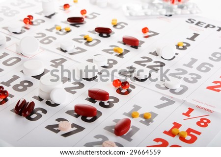 Planning of reception of tablets on basis of a calendar - stock photo