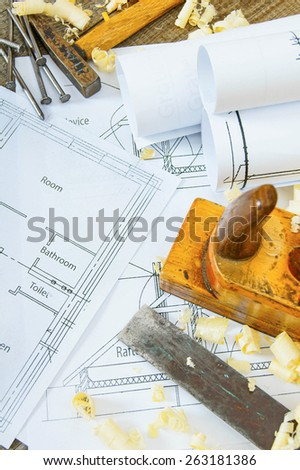Planning of repair of the house. Joiner's works. Drawings for building and working tools on old wooden background.
