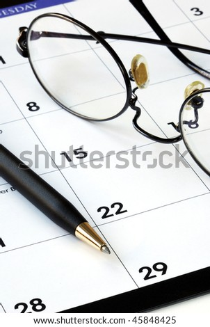 Planning the new month from a calendar with a pen