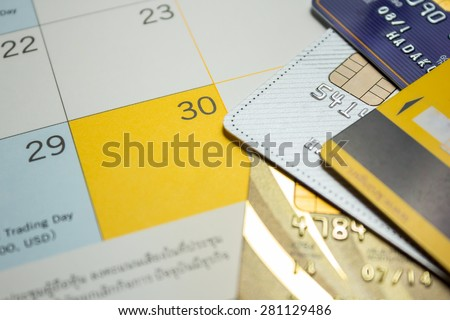 Planning to use credit card on holiday on the calendar. - stock photo