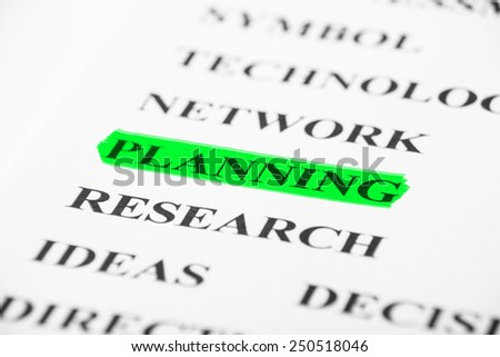 Planning with some other related words on paper. - stock photo