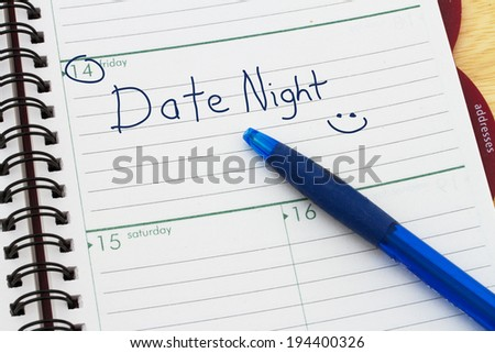 Planning your Date Night, A day blank day planner with a blue pen - stock photo