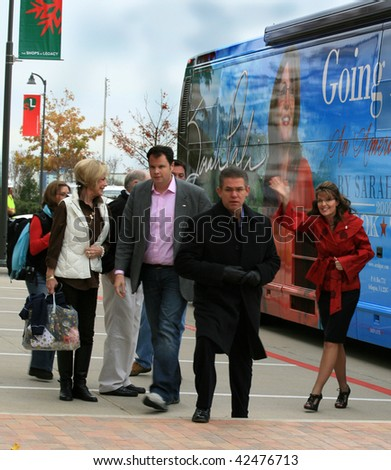 """PLANO, TEXAS - DECEMBER 4: Former governor Sarah Palin waves as she walks out of her tour bus, arriving at signing event for her book """"Going Rogue"""" - stock photo"""