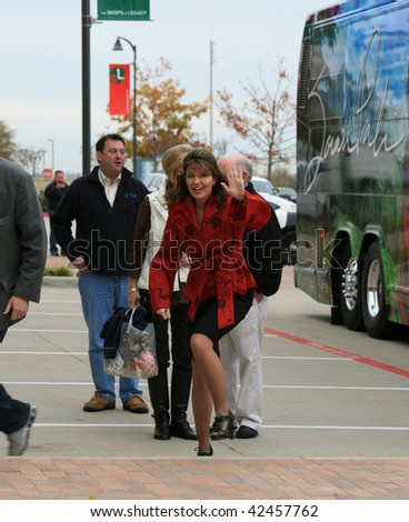 """PLANO, TEXAS - DECEMBER 4:  Former governor Sarah Palin waves while arriving at signing for her book """"Going Rouge"""" in Plano, Texas on December 4, 2009. - stock photo"""