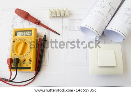 plans and tools for the installation of a house - stock photo
