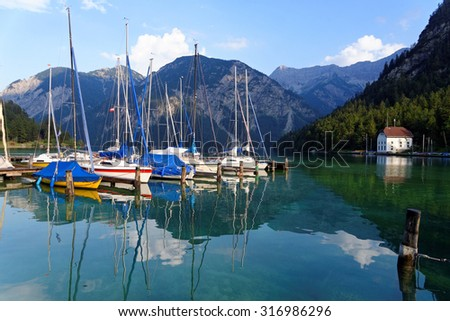 Plansee lake at the Seespitz Camping in the Alps mountain, Austria. - stock photo