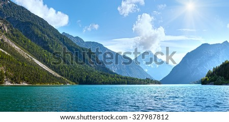 Plansee lake summer panorama with snow on mount top  (Austria).