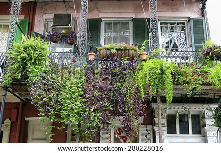 Plant covered balcony in the French Quarter New Orleans - stock photo