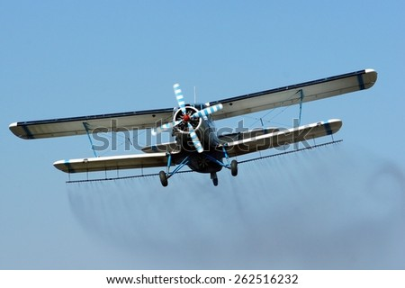 Plant protection spray flying over the land. - stock photo