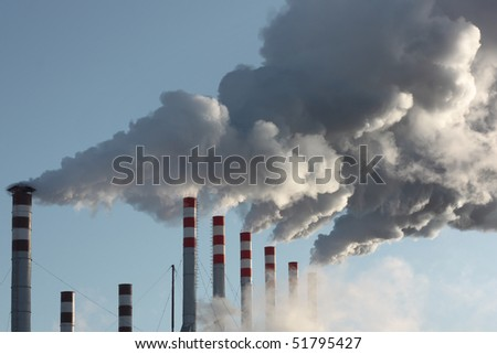 Plant's tubes with smoke and blue sky - stock photo