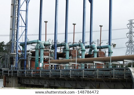 Plant water pump and pipelines - stock photo