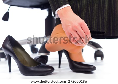 Plantar Fasciitis - hurting toes after wearing every day high heels. - stock photo