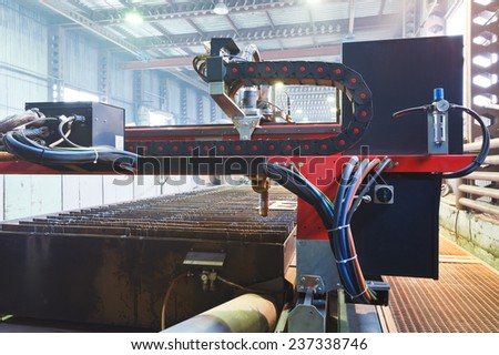 plasma torches of cutting machine close up in mechanical shop