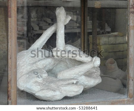Plaster cast of a dog killed at the ancient Roman city of Pompeii, which was destroyed and buried during the eruption of Mount Vesuvius in 79 AD - stock photo